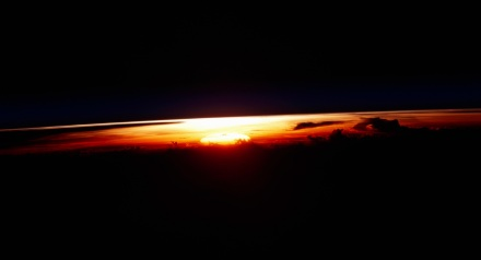Sunrise view taken by the STS-109 crew aboard the Space Shuttle Columbia. NASA Identifier: sts109-345-032
